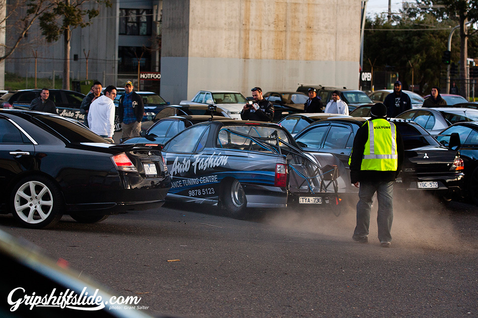 drag car burnout in a crowd